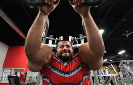 Moustafa Ismail, 24, of Franklin displayed his world-record 31-inch biceps in a recent workout.