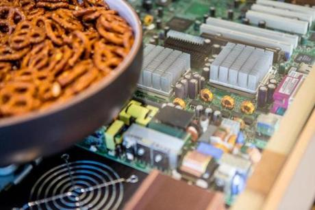 Pretzels are placed on a table adorned with old computer parts during a