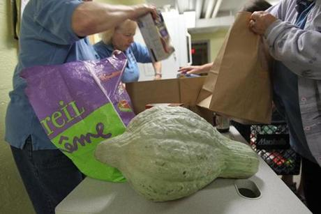 Canton, Ma., 10/03/12, The hubbard squash from Ward's Berry Farm has made its way to the Canton Food Pantry. For a story on the Boston Food Pantry. Section: Magazine. Suzanne Kreiter/Globe staff