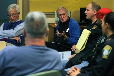 Conway meets with various Boston police officers  and representatives from the Suffolk District Attorney's office at the St. Peter's Teen Center in October to strategize a response to the recent shootings in the Bowdoin-Geneva  neighborhood.