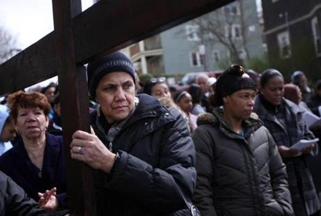 Marlene Texeira of Dorchester and St. Peter's parishioners performed the Stations of the Cross ritual on Good Friday in the Geneva-Bowdoin neighborhood. Each of the 14 stops marked the location of a victim of a stabbing or shooting. This was intersection of Homes and Draper. April 6, 2012.