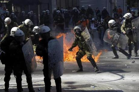 Police in riot gear during demonstrations against wage cuts and austerity measures in Athens last month.