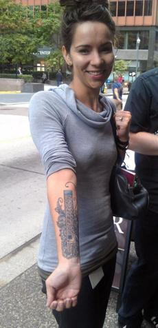 Designer Megan Orsi displays her tattoo of the Adobe Photoshop toolbar.