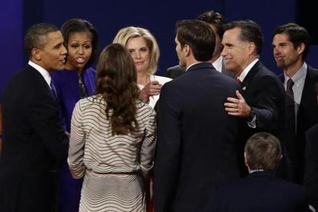 President Obama and Michelle Obama met Mitt and Ann Romney and members of their family.