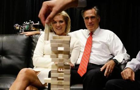 Romney and his wife Ann watched as family members played Jenga before the start.