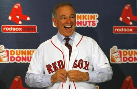 The new Red Sox manager was all smiles when he donned his new jersey at his introductory news conference.