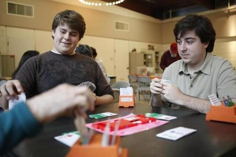 Zach Grossack (left) and his brother Adam playing bridge earlier this month.