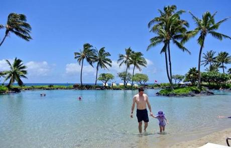 The Grand Hyatt Kauai Resort and Spa offers kids a meandering river that links chlorine-free pools, a 150-foot water slide, and camp activities.