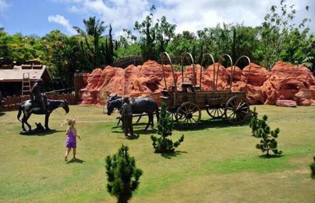 Naina Kai Botanical Gardens' children's garden has everything from a Navajo settlement with a covered wagon to a tropical jungle gym with bridges, tunnels, and slides.