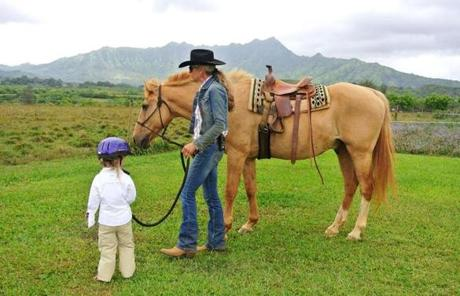 Princeville Ranch on Kauai's north shore offers pony rides, a petting zoo, hikes in the forest, bug collecting, and a chance to learn all about horses.