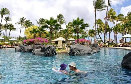 Many Kauai hotels, such as the The Grand Hyatt, offer a kid-friendly starting point for family-style island recreation.