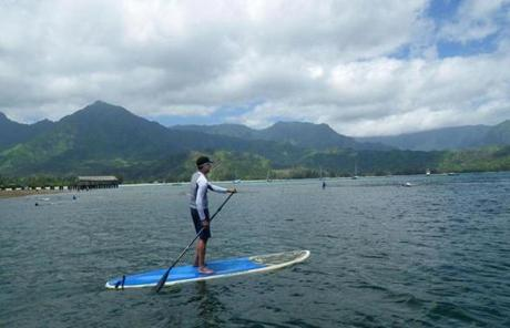 Use a standup paddleboard to explore Hanalei Bay.