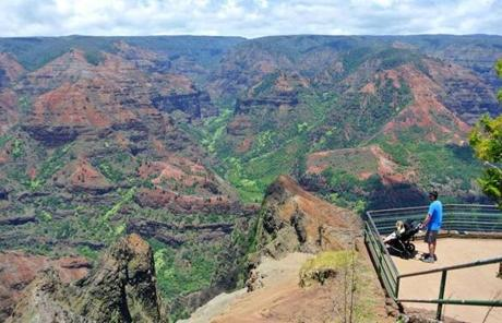 At a lookout Waimea Canyon State Park on the island's west coast, a stroller-friendly path leads to a platform with views of the expansive red-rock canyon.