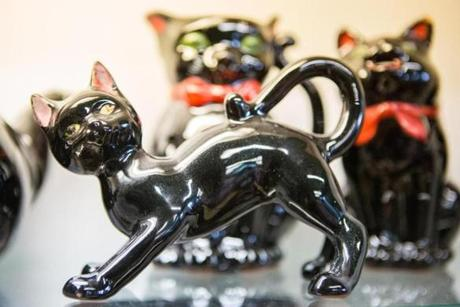 The cats are all vintage 1950's black ceramic made in Japan out of red clay.