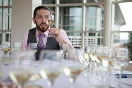 Jason Kilgore examined a white wine before tasting.