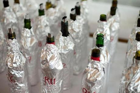 The wine bottles were covered with tinfoil to mask their identity.