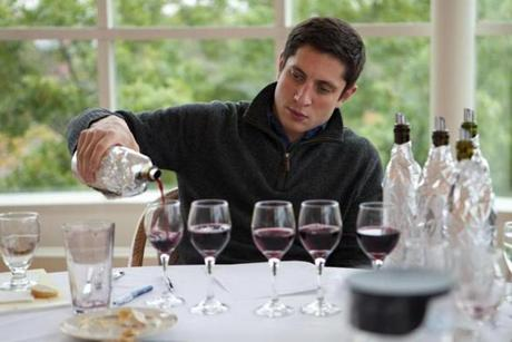 Brahm Callahan poured the final glass of red wine to complete a flight during the tasting.