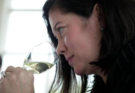 Kate Moore examined the aroma of a white wine before tasting.