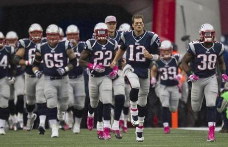 Tom Brady led the Patriots onto the field before the game.
