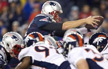 Tom Brady dove over the Broncos defense for a touchdown in the third quarter.