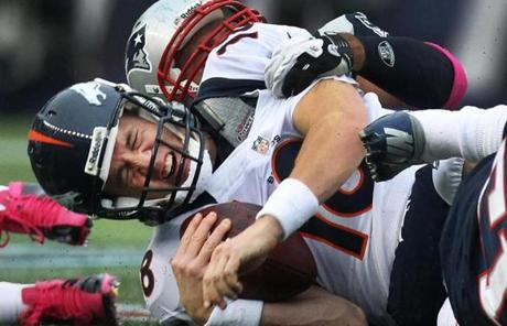 Broncos quarterback Peyton Manning was sacked by Rob Ninkovich in the first quarter.