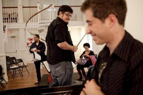 Current Harlem Quartet's cellist Paul Wiancko, center, talked to cellist candidate Matt Zalkind (foreground) at a master's class at Antioch College in Ohio on March 17, 2012.