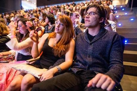 10/05/2012 BOSTON, MA Lauren Hendrix (cq) 24 (left) and Sebastian Neumayer (cq) 29, sit in the auditorium during