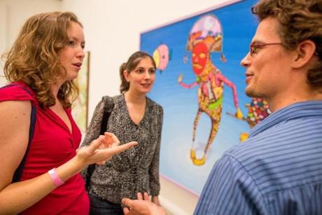 10/05/2012 BOSTON, MA L-R Marti Borkent (cq), Nimet Maherali (cq), and Aerjen Tamminga (cq) look at artwork by Os Gemeos (cq) during