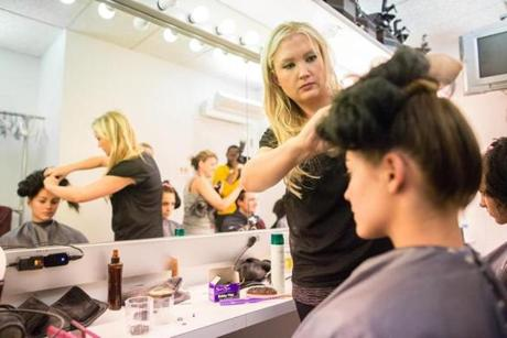 10/05/2012 BOSTON, MA Hairstylist Leah Sugrue (cq) works on model Annie Read's (cq) 18, hair during