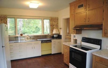 The kitchen needs updating, with older appliances and cabinetry.