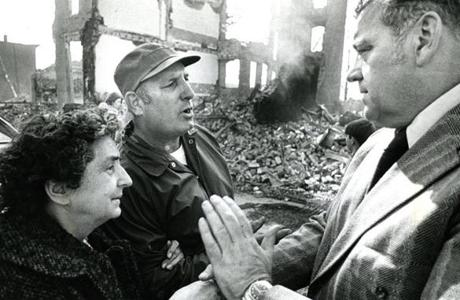 October 15 1973 /  Mrs. William Meuse and her son Jim were burnt out of their 125 Spruce St. home. They talk with with Philip Spelman, the Mayor of Chelsea.