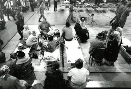 October 14 1973 /  The American Red Cross with volunteers from as far as Nashua, N.H. established headquarters at the Chelsea National Guard Armory to feed the homeless and the hundreds of firefighters, to offer medical care to the elderly and to register displaced victims. By midnight 150 had settled in. Their homes were destroyed and they, unlike others, had no place else to go.