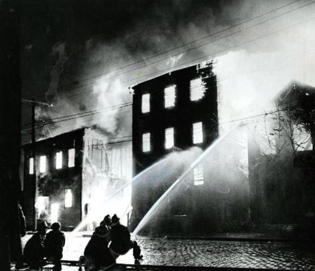 October 14 1973 /  Chelsea firemen fight the blaze at some junk shop businesses on 2nd Avenue. The fire devastated 18 city blocks and destroyed an estimated 303 buildings leaving more than 600 persons unemployed.