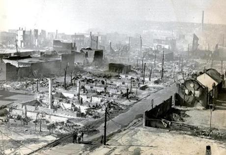 October 15 1973 /  Smoke still rises from buildings that burned in the wind-swept fire that leveled 18 city blocks and destroyed an area 1 mile long and one half-mile wide in this historic port city.