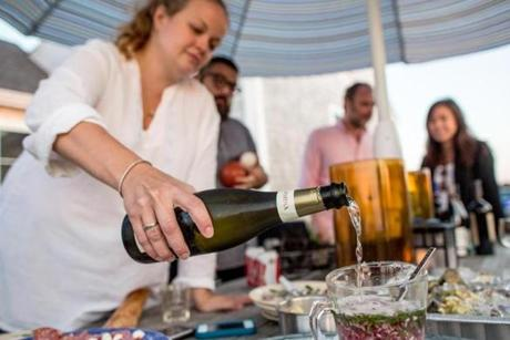 Avery Appleton poured champagne into a mignonette for oysters.