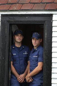 "Boatswain's mates Josh Perkins (left) and Sherman Baldwin in the doorway of Chatham Lighthouse. ""I love it here — this is my home,"" says Baldwin."