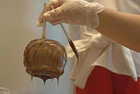 Every fall, the candy maker offers apples dipped in caramel and chocolate.
