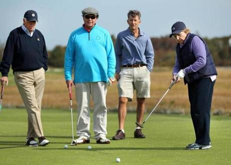 During the RFK Center Celebrity Golf Fundraiser at the Hyannisport Club, Ethel Kennedy putted the ball as Congressman Seny Hoyer from Maryland, funnyman Bobby Farrelly, and Matt McCoy watched.
