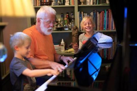 After dinner, Barry Low played the piano with his grandchildren.