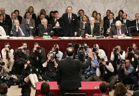 The senator (standing, facing camera) was a relentless interrogator in judicial confirmations.