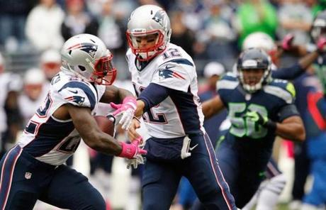 Tom Brady handed the ball off to Stevan Ridley.