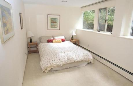 One of two downstairs bedrooms in the home. The bedrooms are good sized and have access to the third full bath.