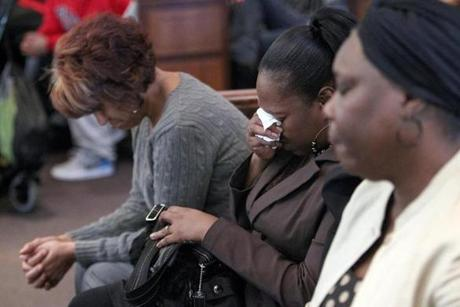 Women reacted during the arraignment of 14-year-old Ernest Watkins IV at Dorchester District Court, Monday.
