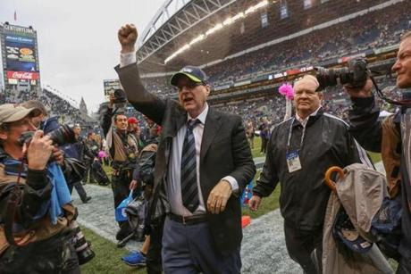 Seahawks owner Paul Allen raised his fist as he walked off the field following the victory.
