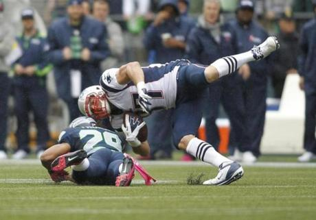 Patriots tight end Rob Gronkowski was upended by Earl Thomas in the first half.