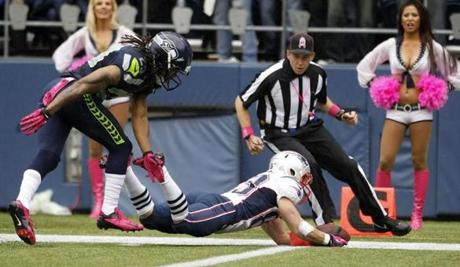 New England Patriots receiver Wes Welker, scored a touchdown ahead of Seattle Seahawks' Earl Thomas in the first half.