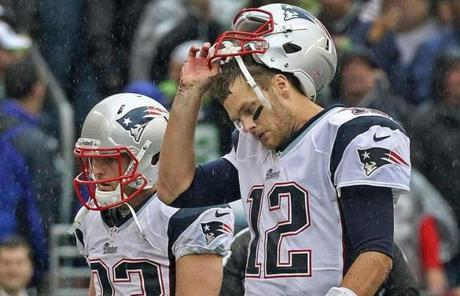Tom Brady (right) threw two interceptions in the loss. He has three on the season.