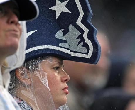 This Patriots fan was both wet and unhappy as she watched from an end zone seat.