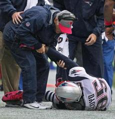 Patriots wide reciever Brandon Lloyd appeared to injure his shoulder after he dove and missed a pass late in the game.
