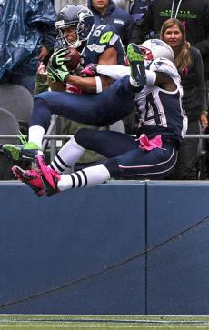 Seattle wide receiver Doug Baldwin jumped to grab a first quarter touchdown pass from quarterback Russell Wilson.